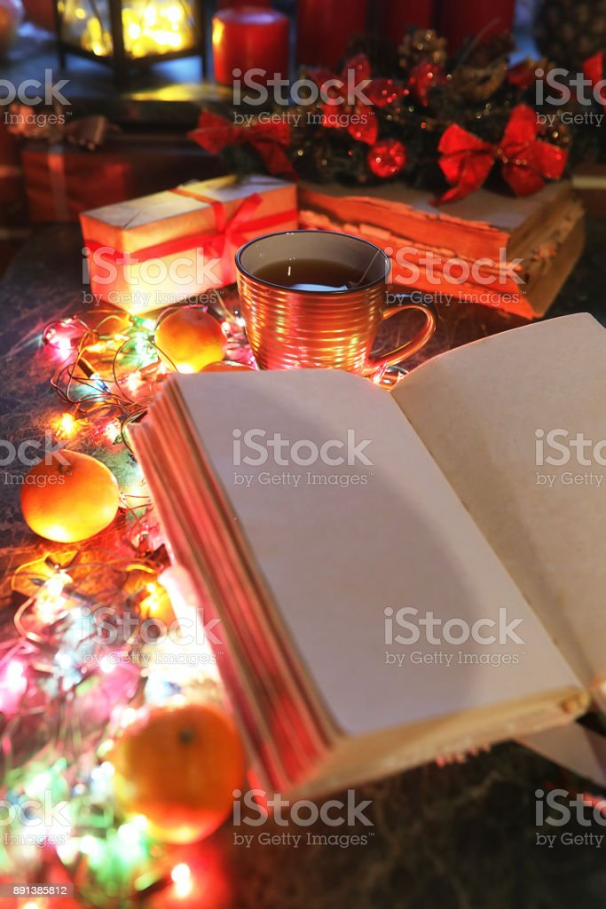 Christmas Table Fruits And Drinks With Color Garland Stock Photo
