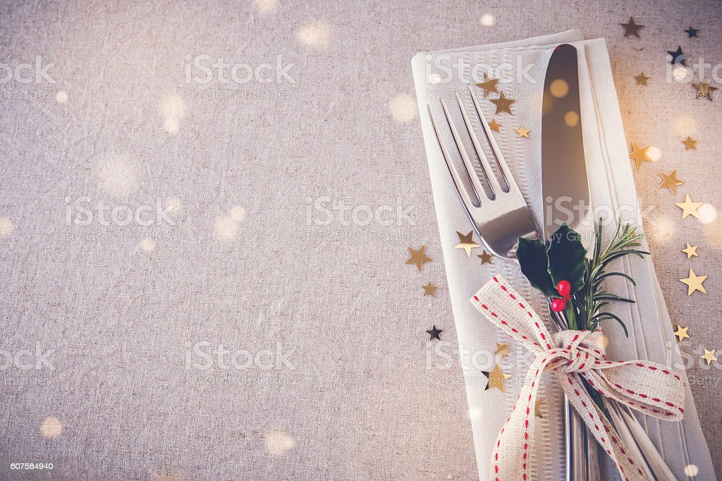 Christmas table place setting, copy space fairy light toning bac stock photo