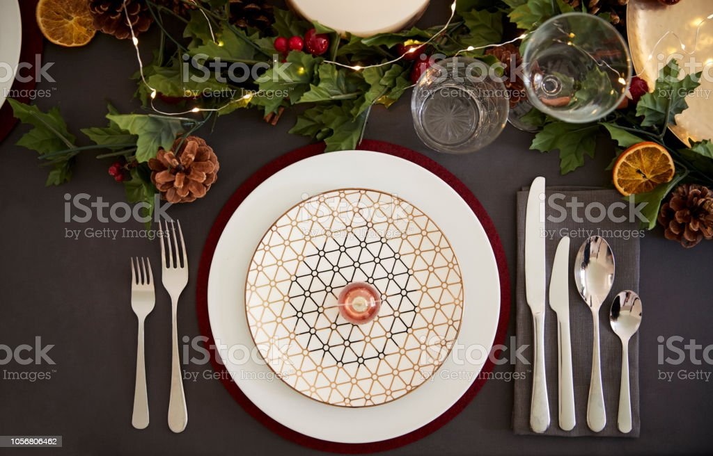 Christmas Table Place Setting With Bauble Arranged On A Plate And