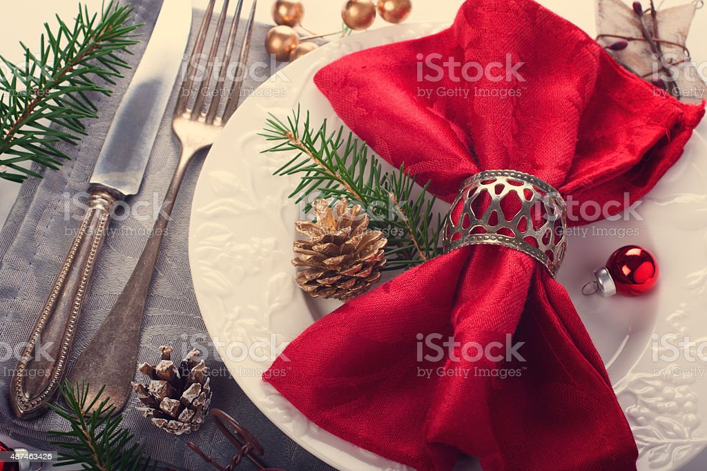 Christmas table place setting with decorations stock photo