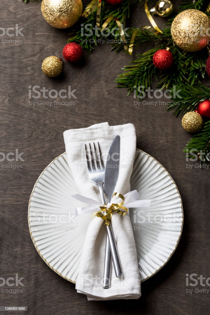 Christmas Table Setting With Fork And Knife And Christmas Decorations On Plate Stock Photo Download Image Now Istock