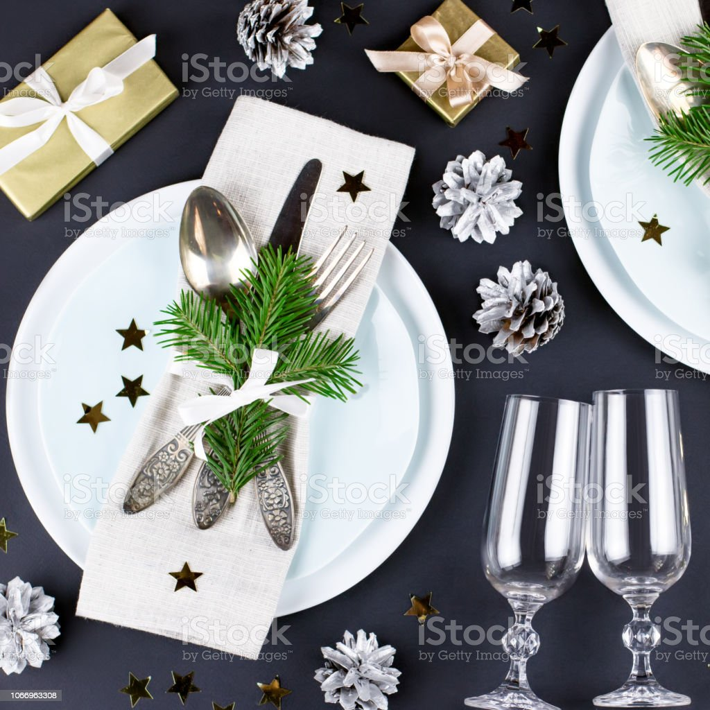 Christmas Table Setting With Plates Silverware Gift Box And Decorations In Black And Gold Colors Stock Photo Download Image Now Istock