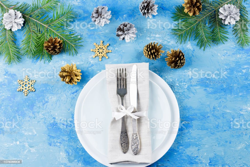 Christmas Table Setting With Plates Silverware Presents And