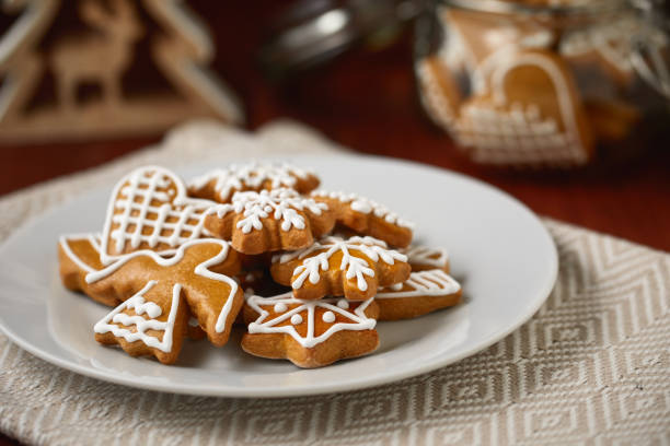 Christmas table with plate full of gingerbreads, homemade biscuits stock photo