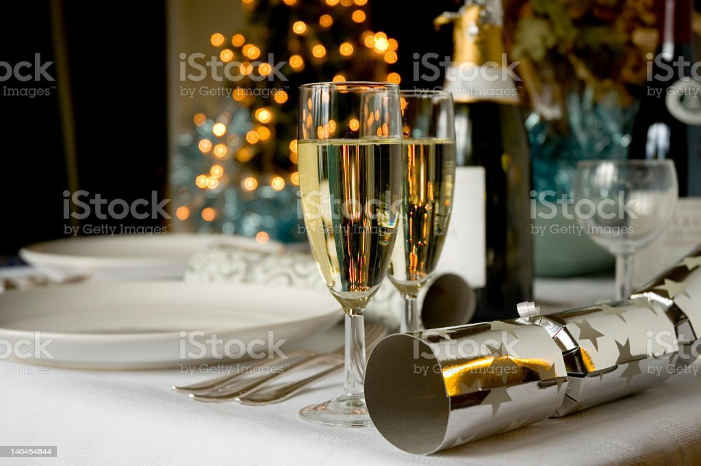 Christmas table with wine and dishes stock photo