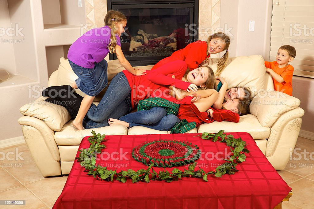 Christmas Teens and Children with Fun and Problems on Couch stock photo