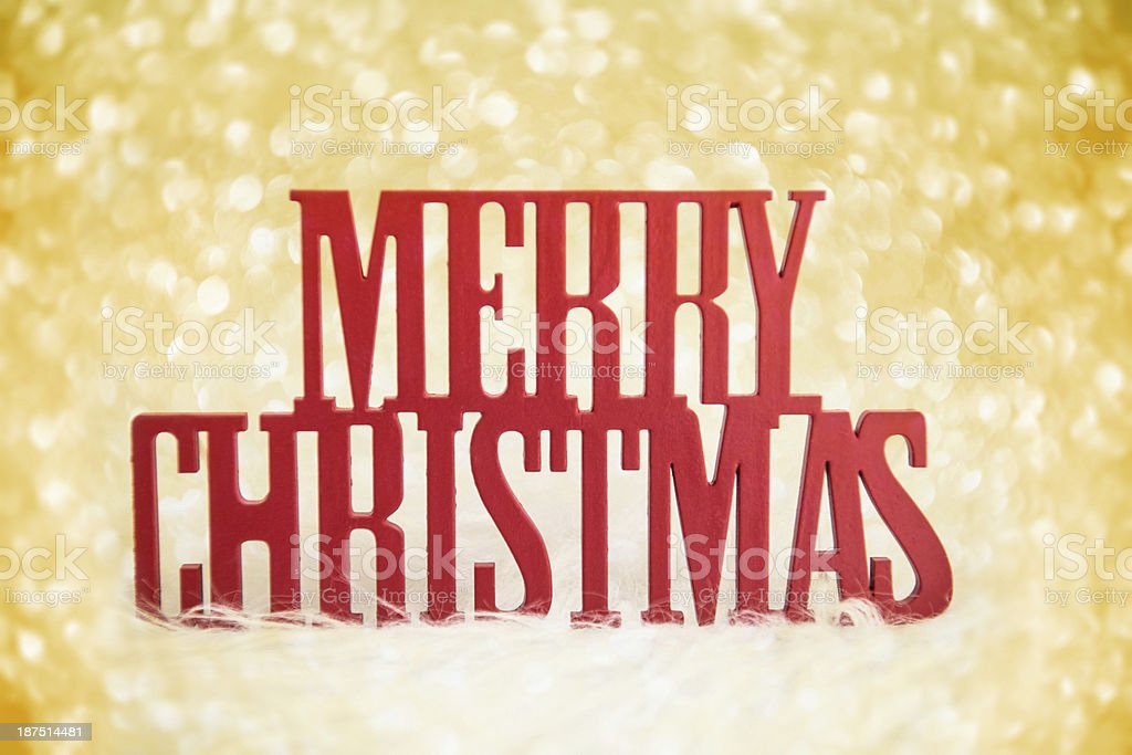 Christmas text on a gold bokeh royalty-free stock photo