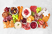 istock Christmas theme charcuterie board. Top view against a white marble background.l 1282171770
