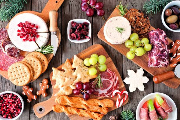 Christmas theme charcuterie top view table scene against dark wood stock photo