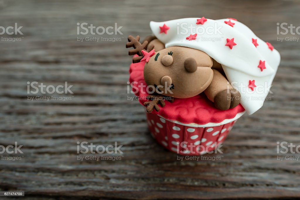christmas theme cup cake on wooden background stock photo