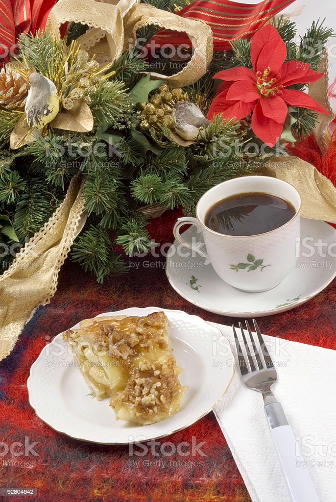 Christmas theme with apple pie black coffee and poinsettia background royalty-free stock photo