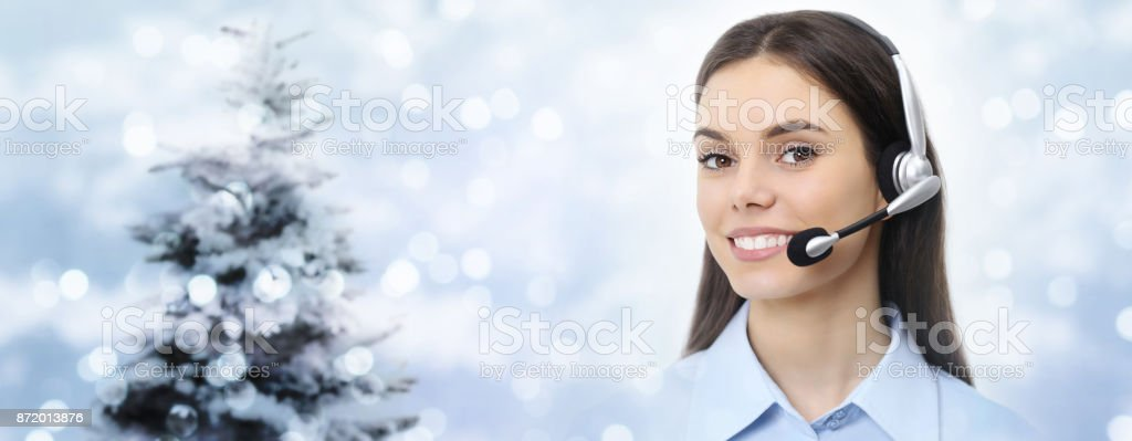 christmas theme woman with headset smiling isolated on christmas background stock photo
