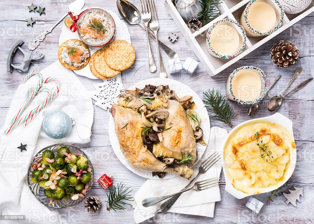 Christmas themed dinner table stock photo