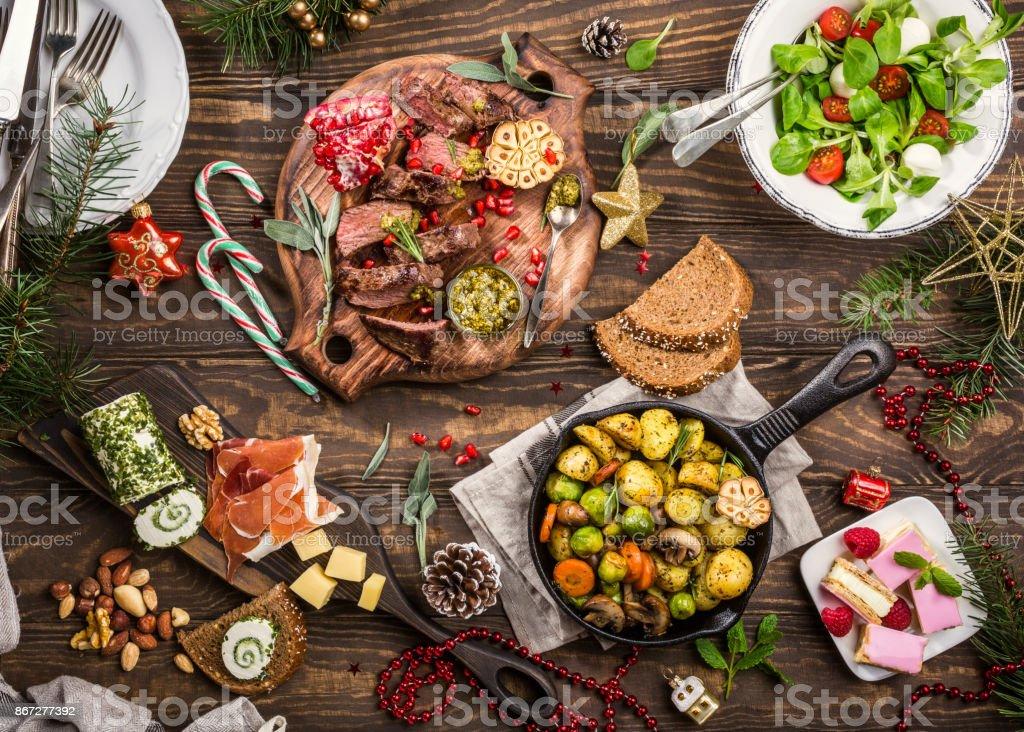 Christmas themed dinner table stock photo