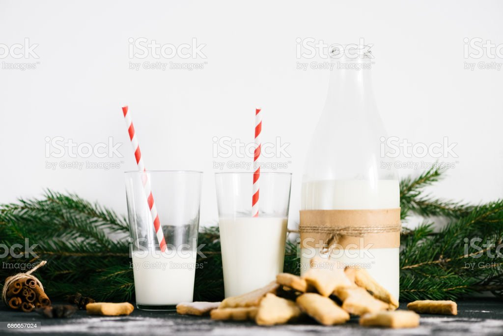 Christmas themed homemade cookies and milk on the table royalty-free stock photo