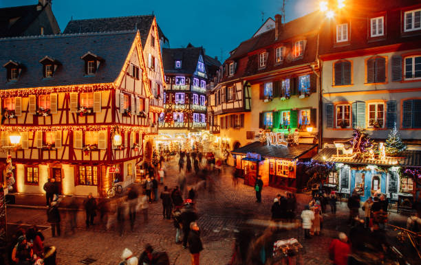 Christmas time in Colmar, Alsace, France Old town illuminated and decorate magical like a fairy tale in Noel festive season. People togetherness and happiness enjoying Christmas markets in Colmar, Alsace, France. hauts de france stock pictures, royalty-free photos & images