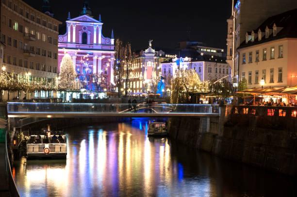Christmas time in Ljubljana Ljubljana, Slovenia - Preseren square at Christmas time ljubljanica river stock pictures, royalty-free photos & images