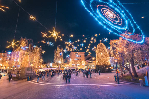 Christmas time in Ljubljana, Slovenia. Prešeren square in Ljubljana City Centre with big Christmas tree, Christmas lights and decoration at night. ljubljana stock pictures, royalty-free photos & images