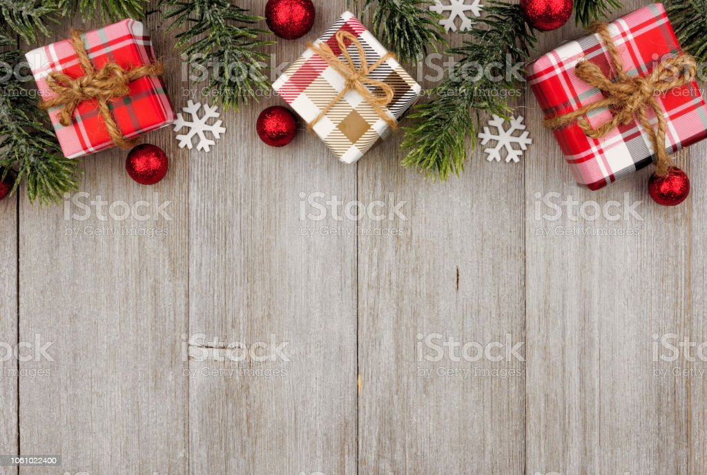 Christmas Top Border.Christmas Top Border Of Gifts And Tree Branches On Gray Wood Stock Photo More Pictures Of Above
