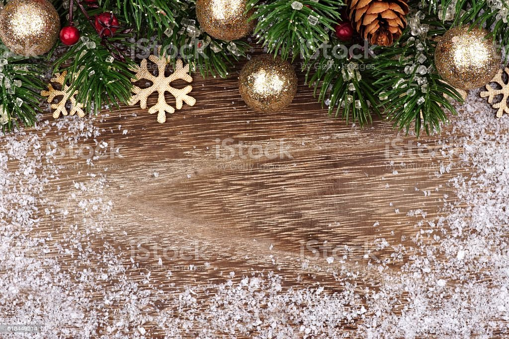 Christmas Top Border With Gold Ornaments Branches And Snow Royalty Free Stock Photo