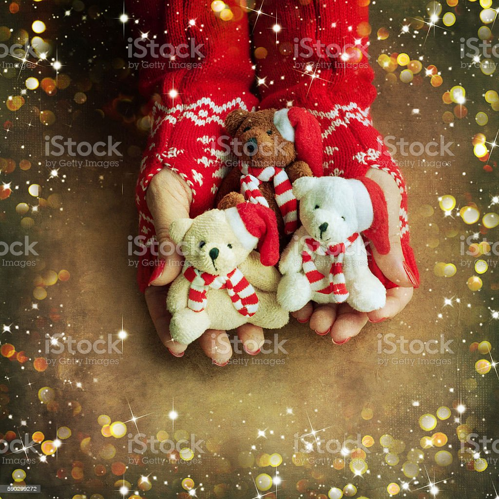 Christmas toy bear  in woman hands royaltyfri bildbanksbilder