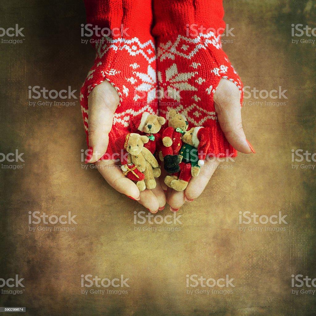 Christmas toy bear  in woman hands Стоковые фото Стоковая фотография