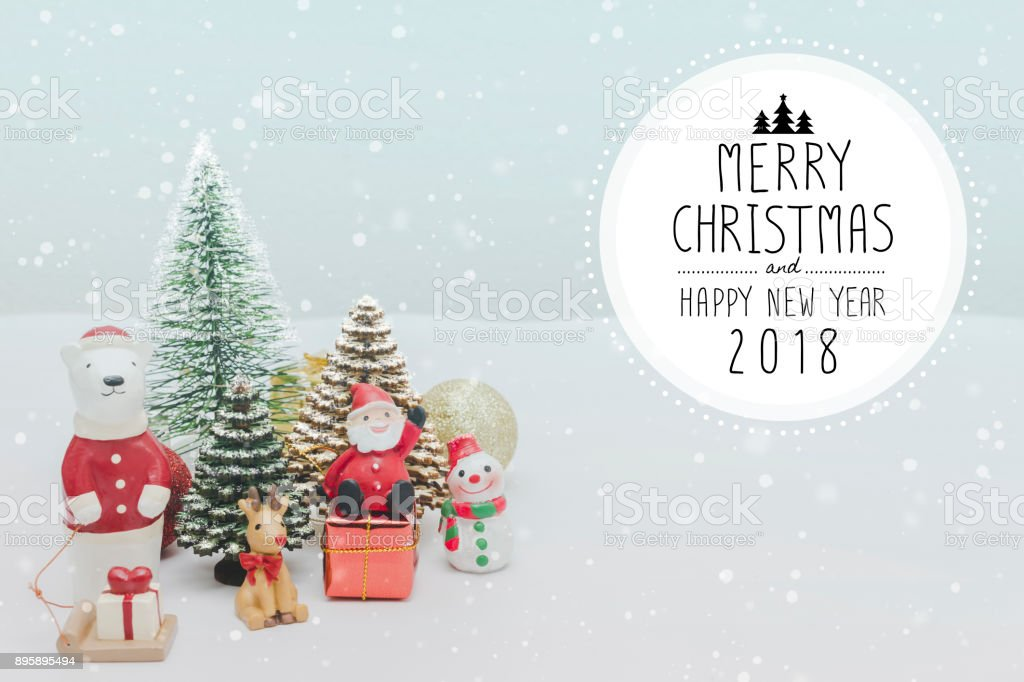Christmas toy doll & Christmas and New Year 2018 holidays gift box with decorative ornament on white snow with falling snow effect background.Gifts and congratulations concept. stock photo