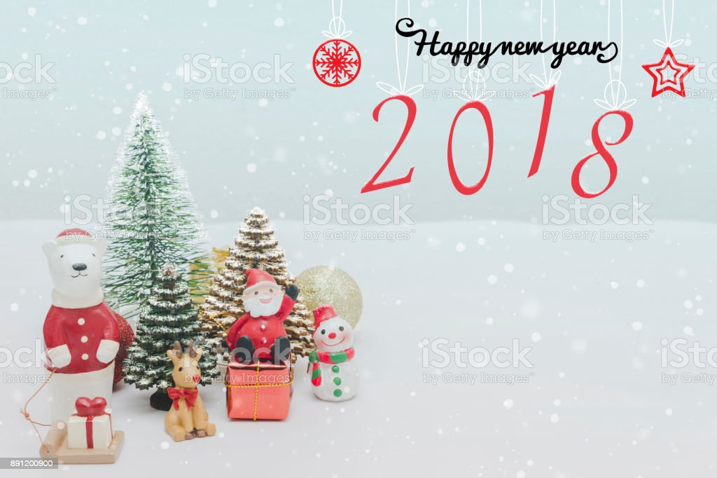 Christmas toy doll ,Christmas tree and Happy New Year 2018 holidays gift box with decorative ornament on white snow with falling snow effect background.Gifts and congratulations concept. stock photo