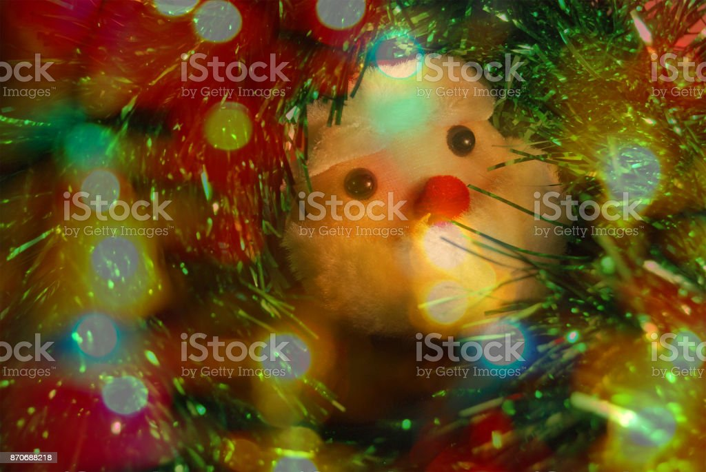 Christmas toy Santa Claus in a green shiny garland stock photo