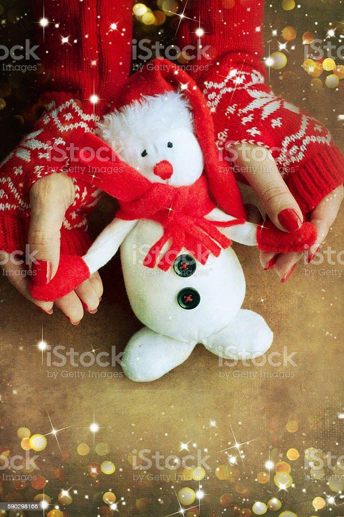 Christmas toy snowflake in woman hands royaltyfri bildbanksbilder