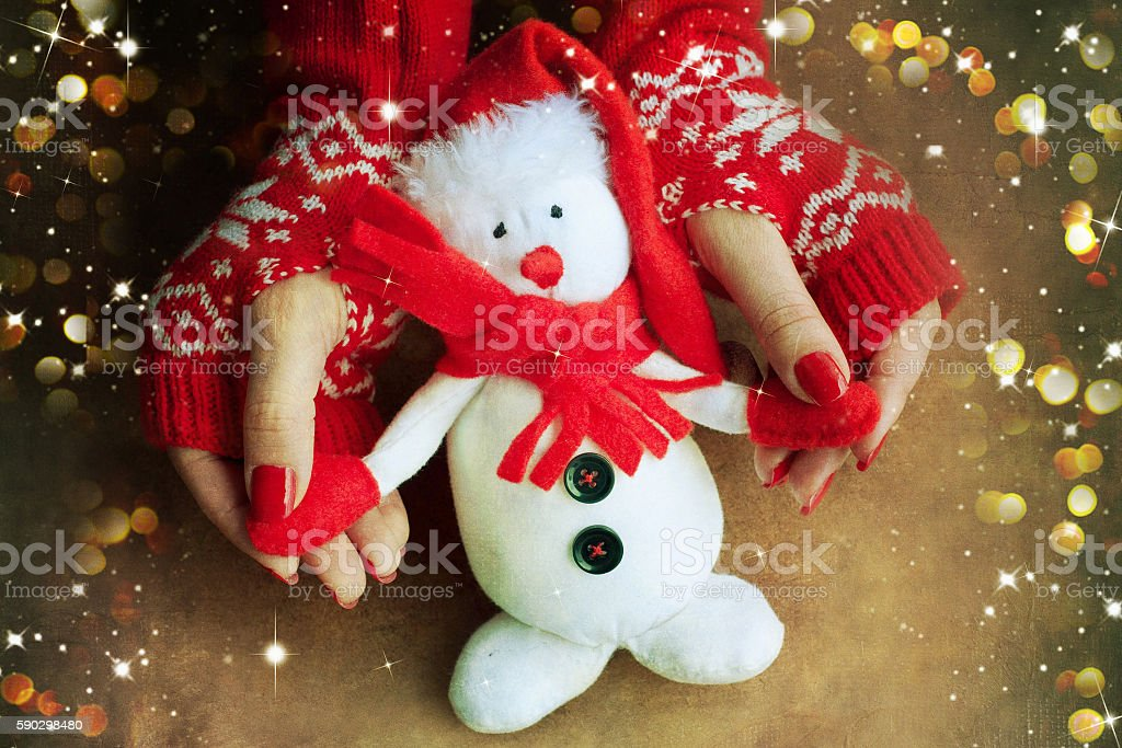 Christmas toy snowflake in woman hands royaltyfri bildbanksbilder