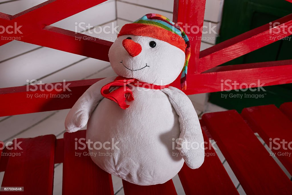 Christmas toy snowman on a bench stock photo