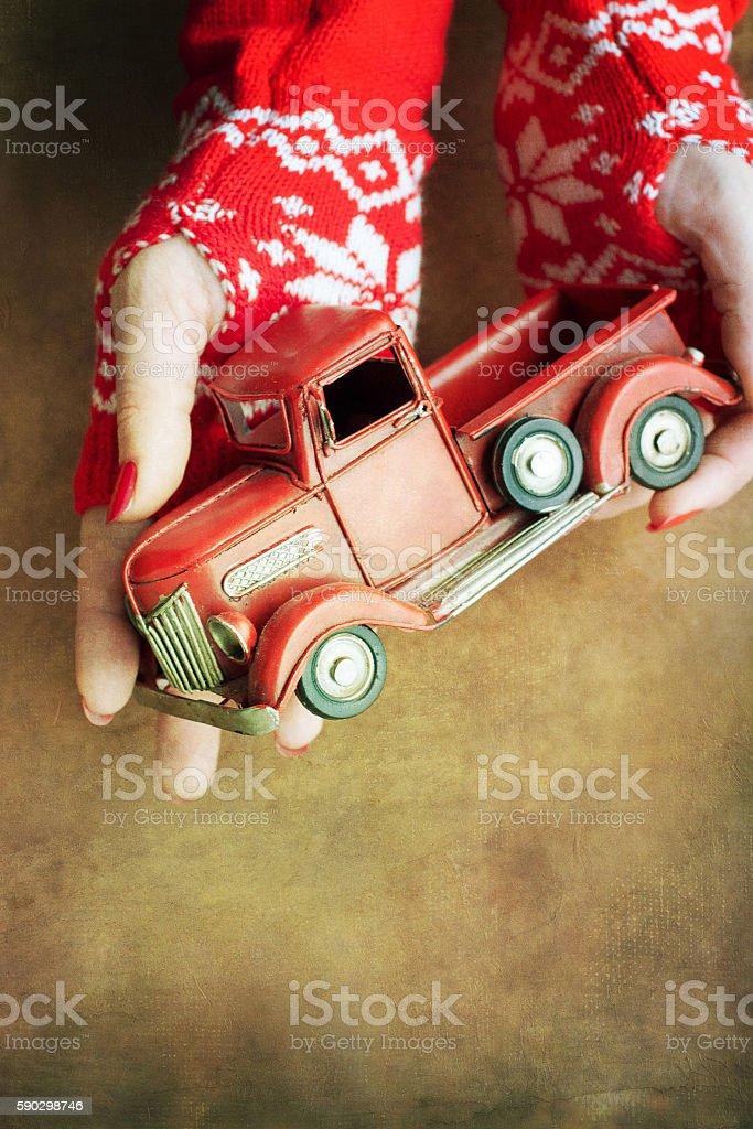 Christmas toy truck in woman hands Стоковые фото Стоковая фотография
