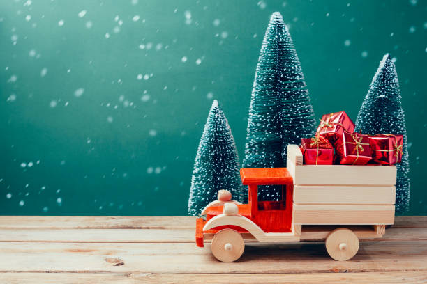 Christmas toy truck with gift boxes and pine tree on wooden table picture id868049288?b=1&k=6&m=868049288&s=612x612&w=0&h=8hkwq7ajaqgoiqcpgpfrzieqtg9a3g9tj27m ixmaja=