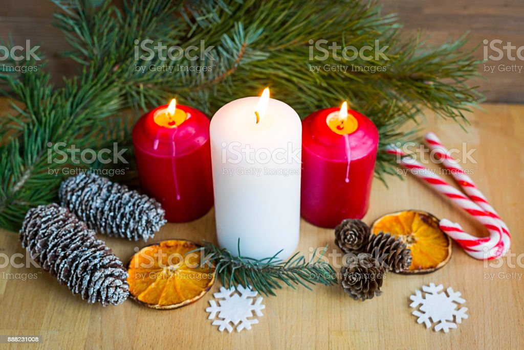 Christmas toys, lighted candles and other xmas decorations. Greeting card, holiday concept. stock photo