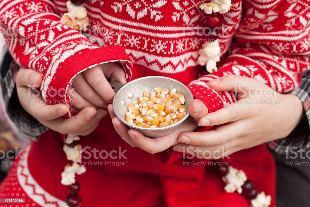Christmas Tradition of Stringing Popcorn and Cranberries for Trimming Tree royalty-free stock photo