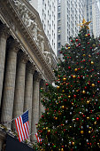 """""""New York City, USA - December 10, 2012: A decorated five-story tall Christmas tree seen in front of the New York Stock Exchange Building along Broad Street, Financial District of Lower Manhattan."""""""