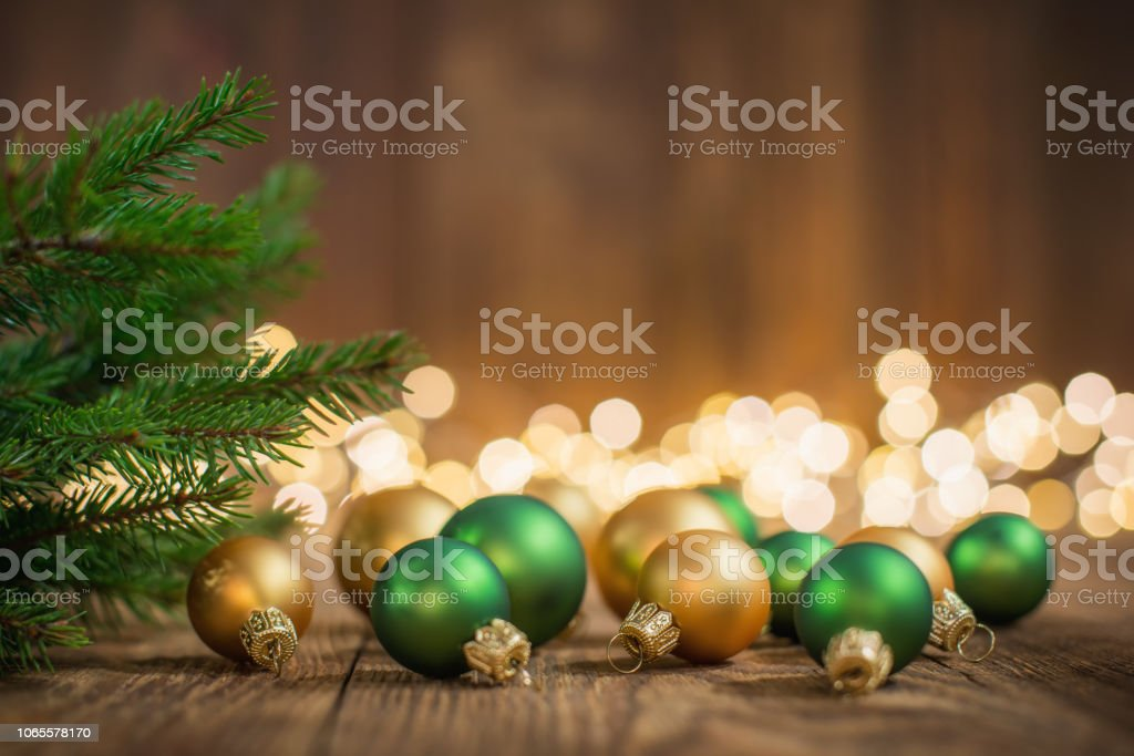 Christmas Tree and baubles on rustic wood and sparkles light backgorund stock photo