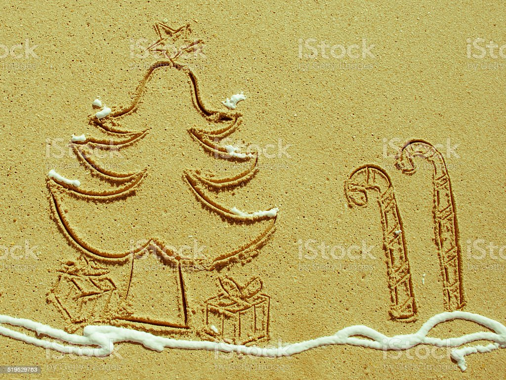 Christmas Tree And Candy Stick Drawing In Sand Stock Photo More