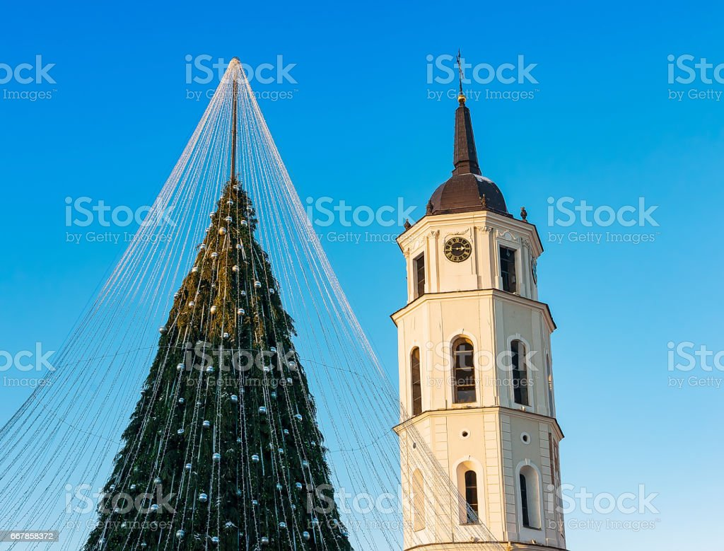 Christmas tree with decoration and Xmas market, and the Bell tower at...