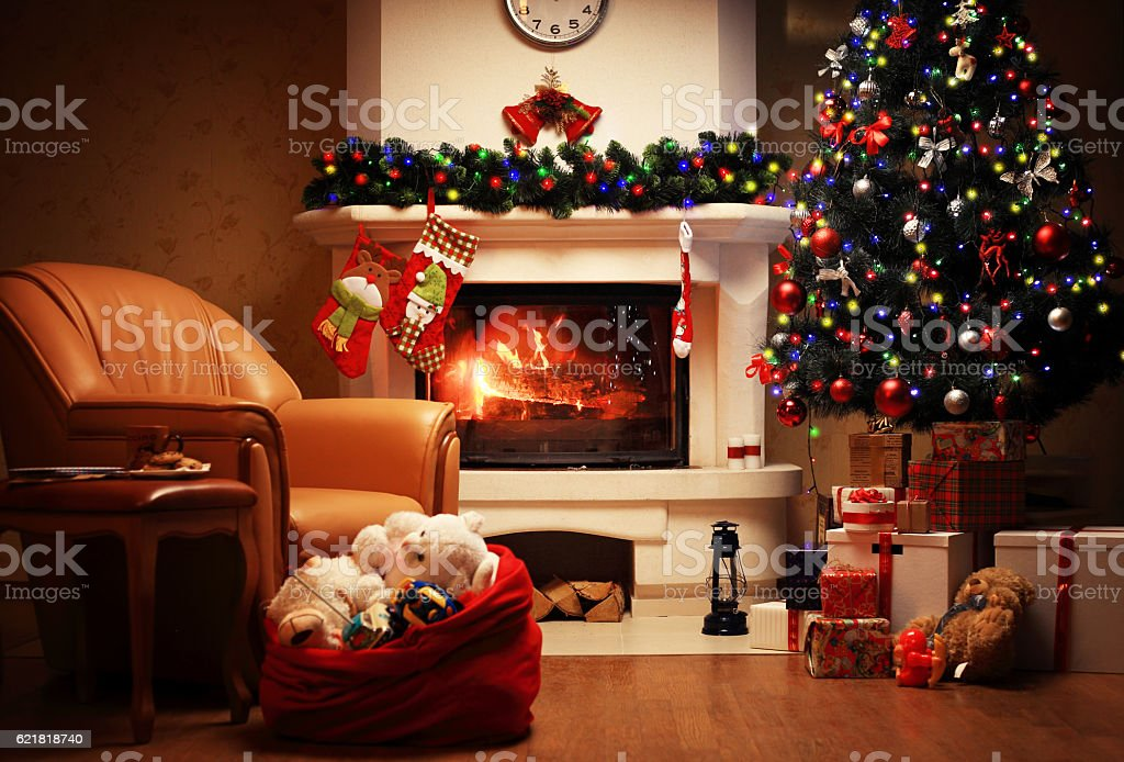 Christmas Tree and Christmas gift boxes in interior with fireplace stock photo