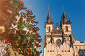 Christmas tree and Church of our Lady Tyn in Prague at New Year Time