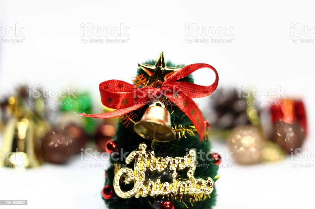 e29fcbef92f4 Christmas tree and colorful Christmas decorations gift box, ball, pine  cones on white background - Stock image .