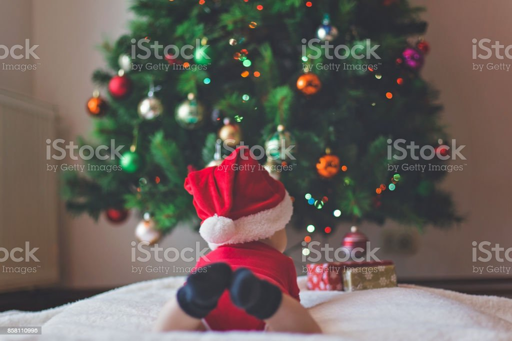 Christmas tree and cute baby stock photo