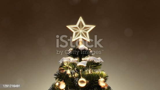 Christmas tree and decoration gift boxes under with bokeh lights snowfall at night