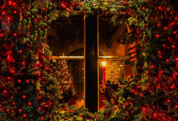 julgran och spis sett genom ett trästuga fönster - cozy at christmas bildbanksfoton och bilder