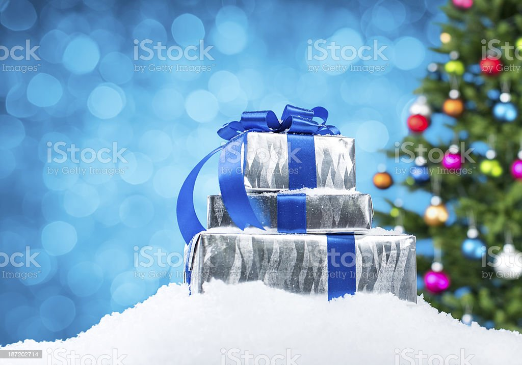 Christmas tree and gifts on blue. stock photo