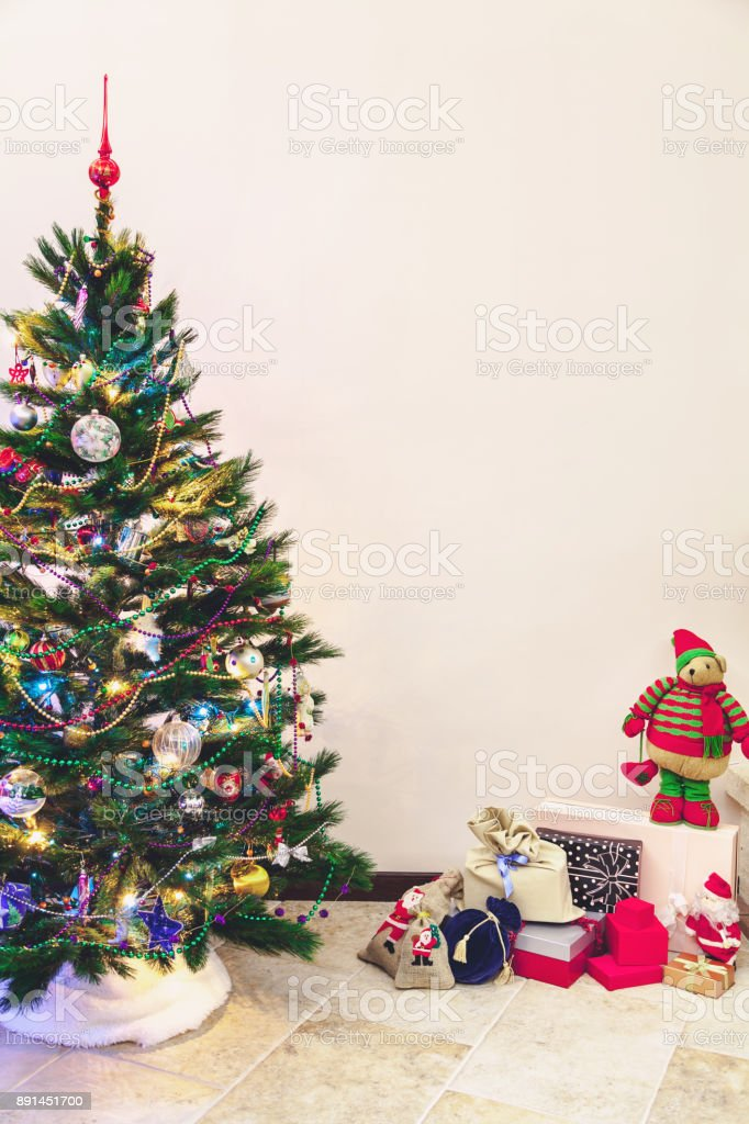 Christmas Tree And Gifts Stand On White Wall Background Stock Photo Download Image Now Istock