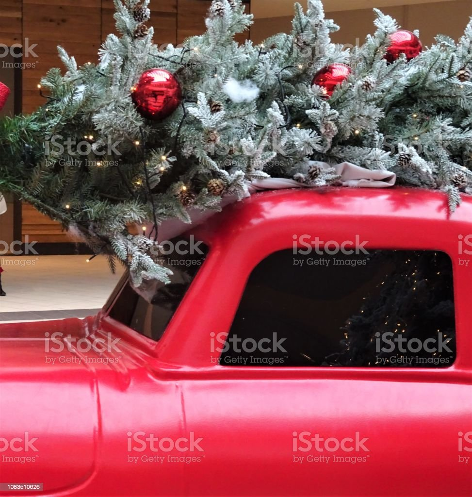 christmas tree and greenery with red truck picture id1083510626