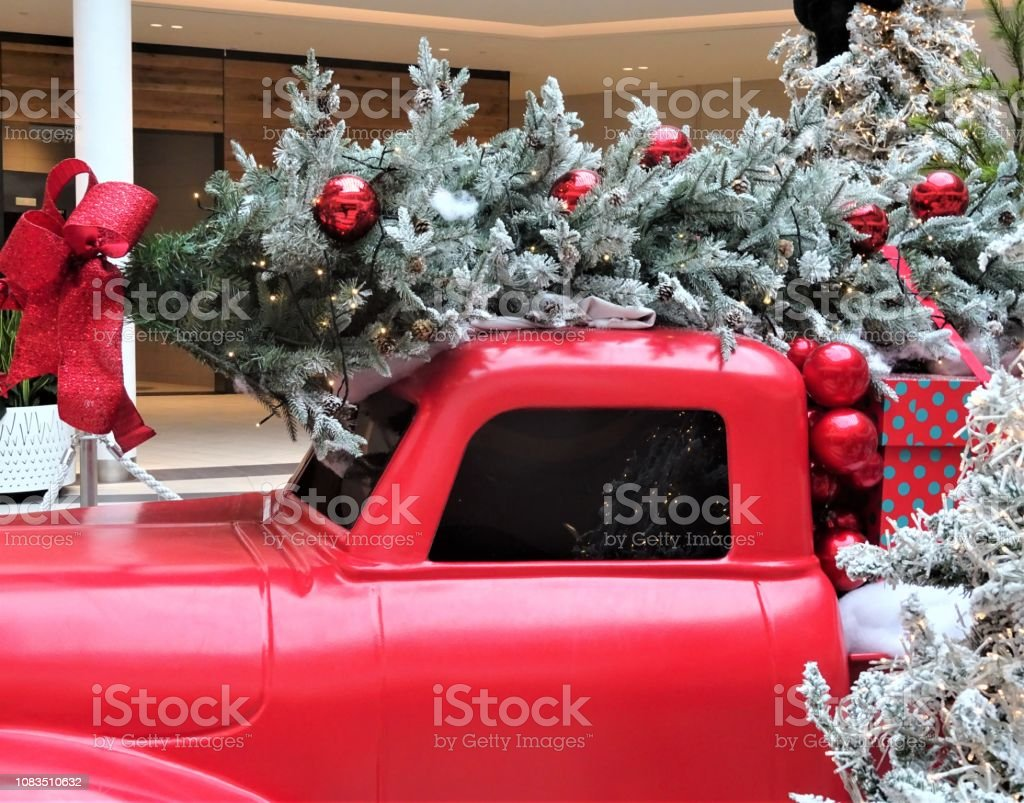christmas tree and greenery with red truck picture id1083510632